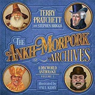 The Ankh-Morpork Archives: Volume One, Terry Pratchett, Blue, Faces, Fancy Letters, Wizard, Paul Kidby, Stephen Briggs, Cover