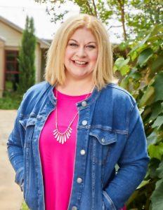 Erin Nicholas, Author, Blonde Hair, Jeans Jacket, Pink Shirt, Plants, Photograph